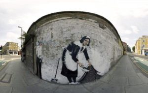 Banksy - Sweeping It Under The Carpet - 2006
